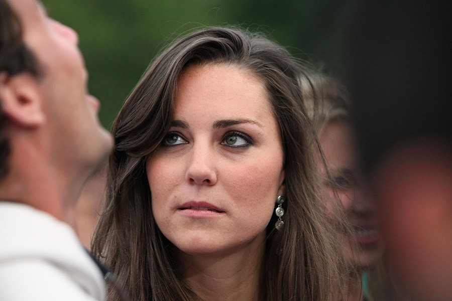 Kate Middleton (R) and guest attend the 46664 concert in celebration of Nelson Mandela's life at Hyde Park