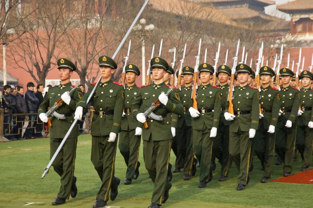 Chinese military soldiers marching.