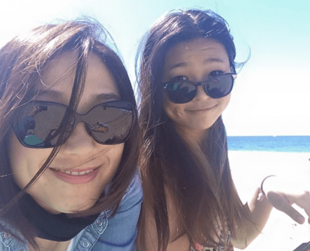 Chloe Kim and her mother at a beach.