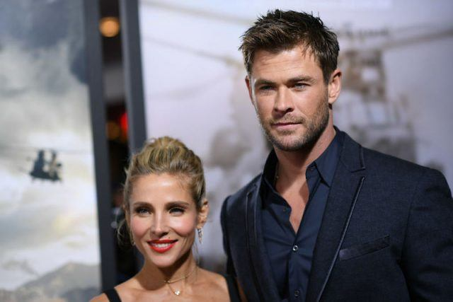 Chris Hemsworth and Elsa Pataky posing for photographers on a red carpet.