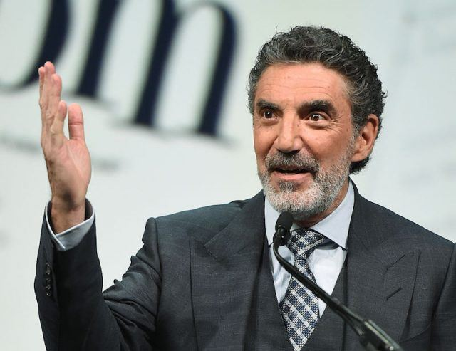 Chuck Lorre speaking while wearing a black suit.