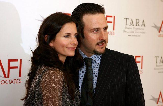 Courteney Cox and David Arquette standing closely together as they pose for photos on a red carpet.