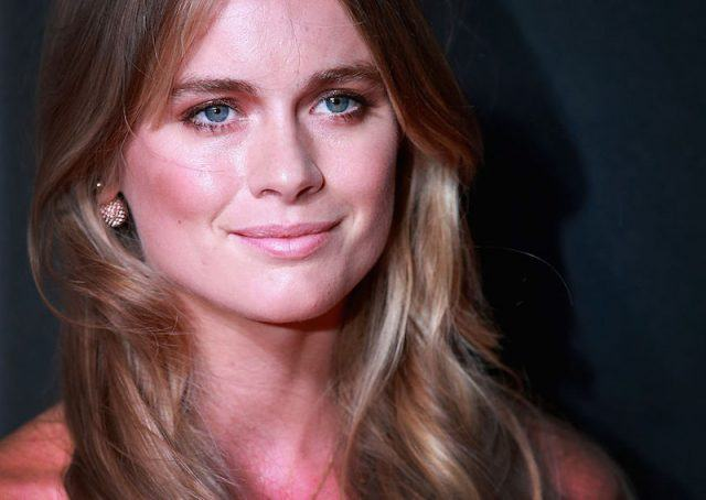 Cressida Bonas smiling in front of a dark background.