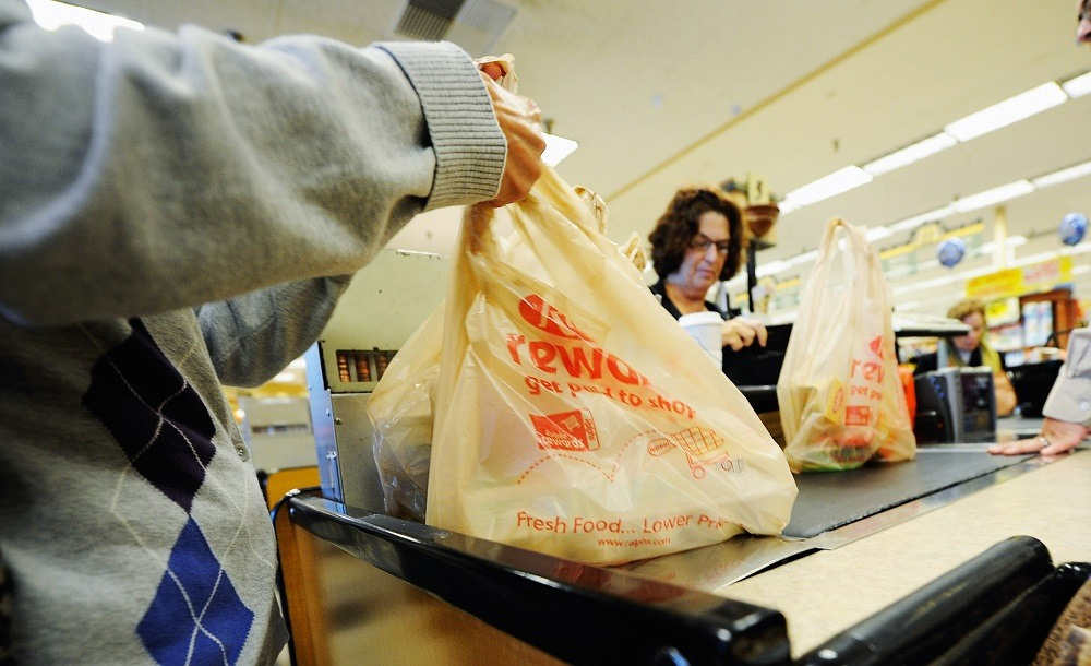 Customers of Ralphs supermarket use plastic bags