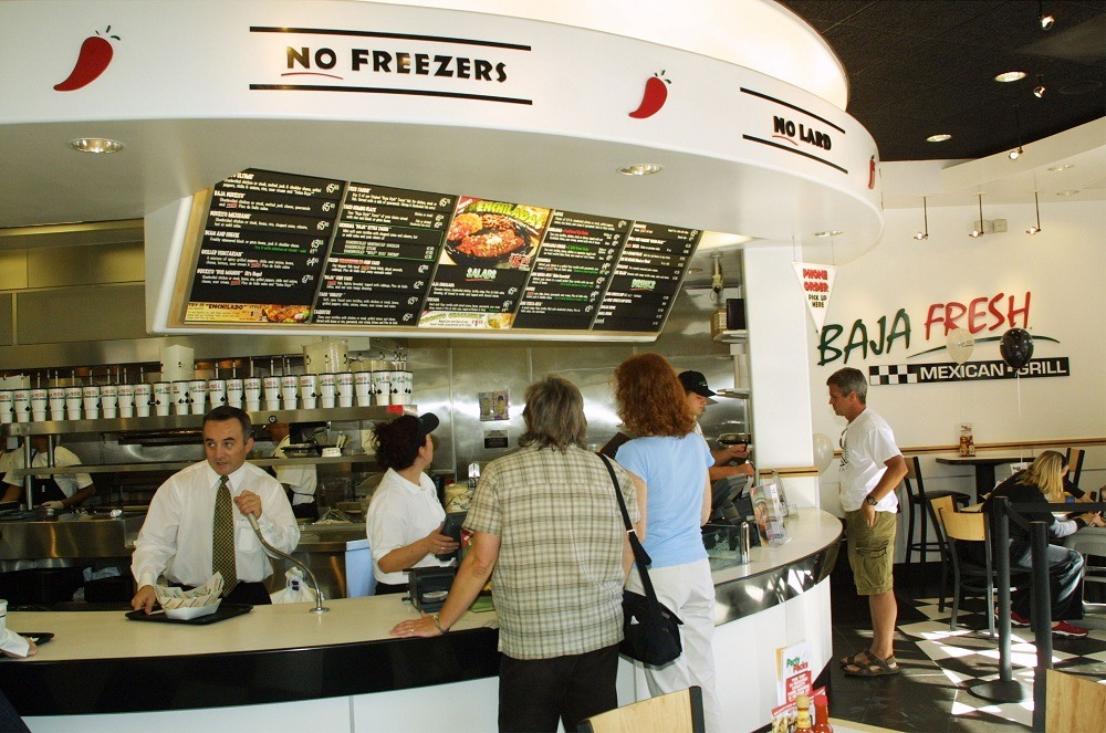 Customers place orders for food during the opening of the 200th Baja Fresh restaurant