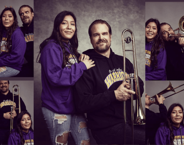David Harbour posing with a student.