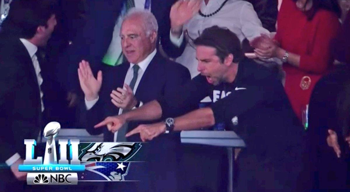 Bradley Cooper points his fingers and shouts