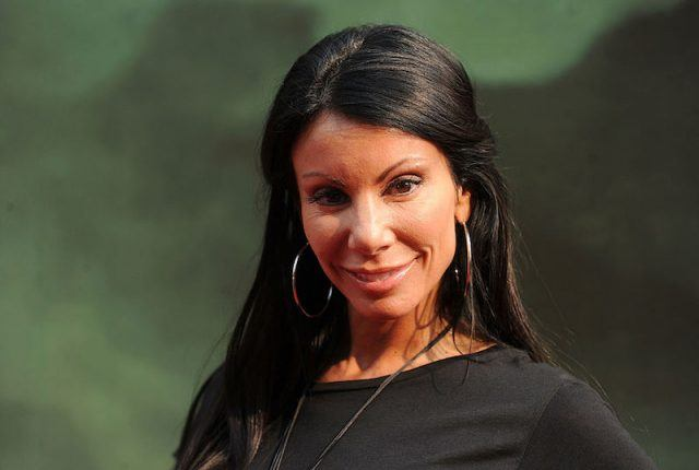 Danielle Staub wearing hoop earrings and a black shirt.