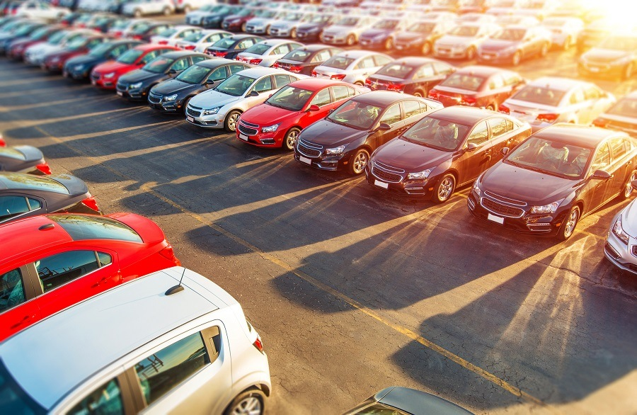 Dealer New Cars Stock. Colorful Brand New Compact Vehicles