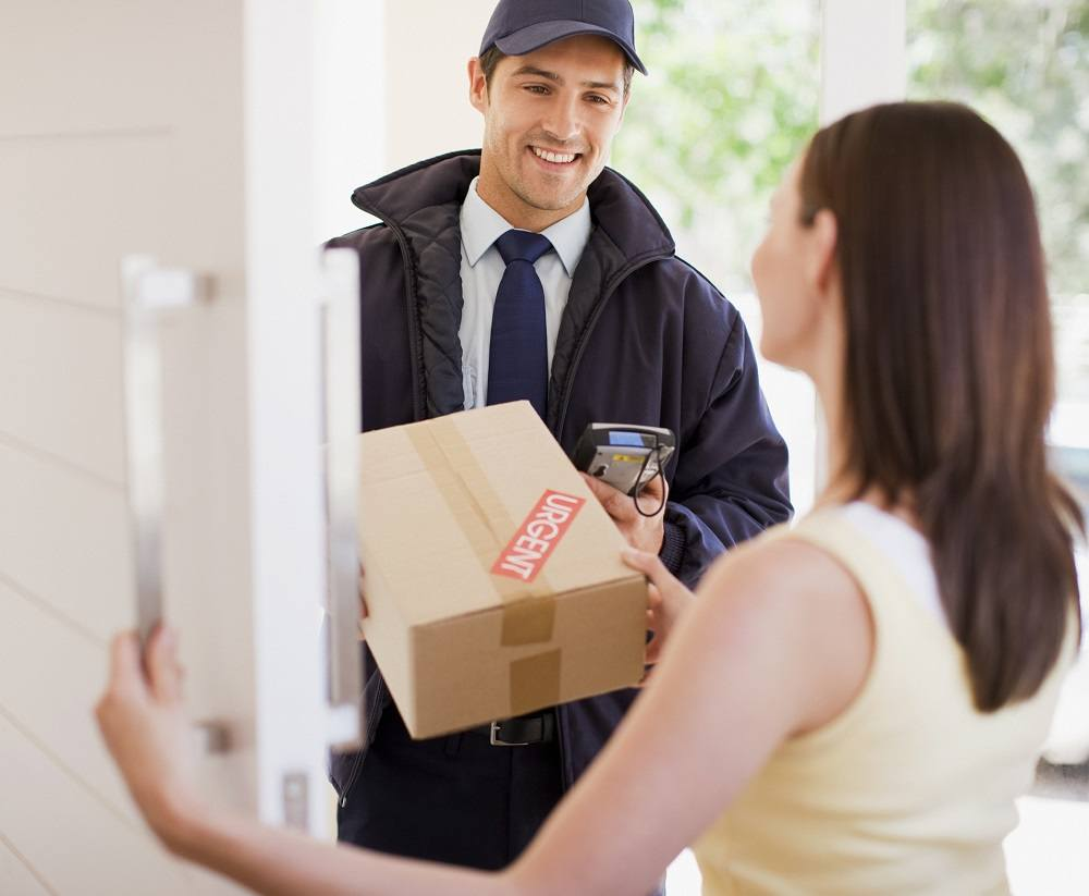 Delivery man handing box