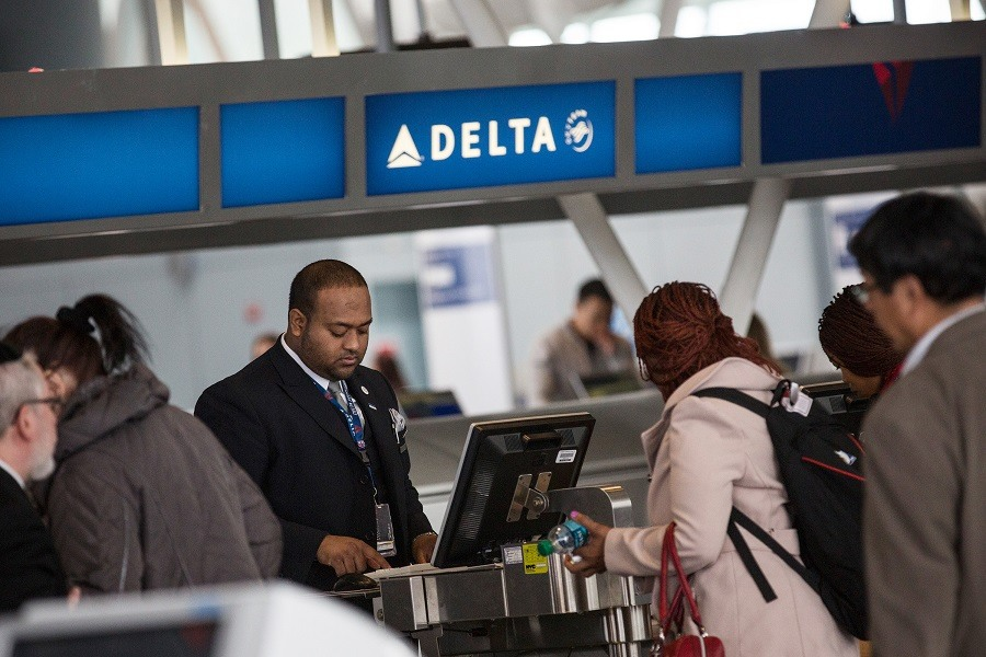 Customers check in at Delta's counter