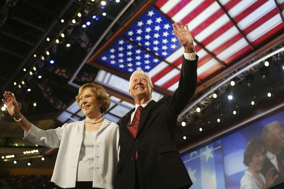 Former U.S. President Jimmy Carter and his wife Rosalynn wave to the audience during the Democratic National Convention