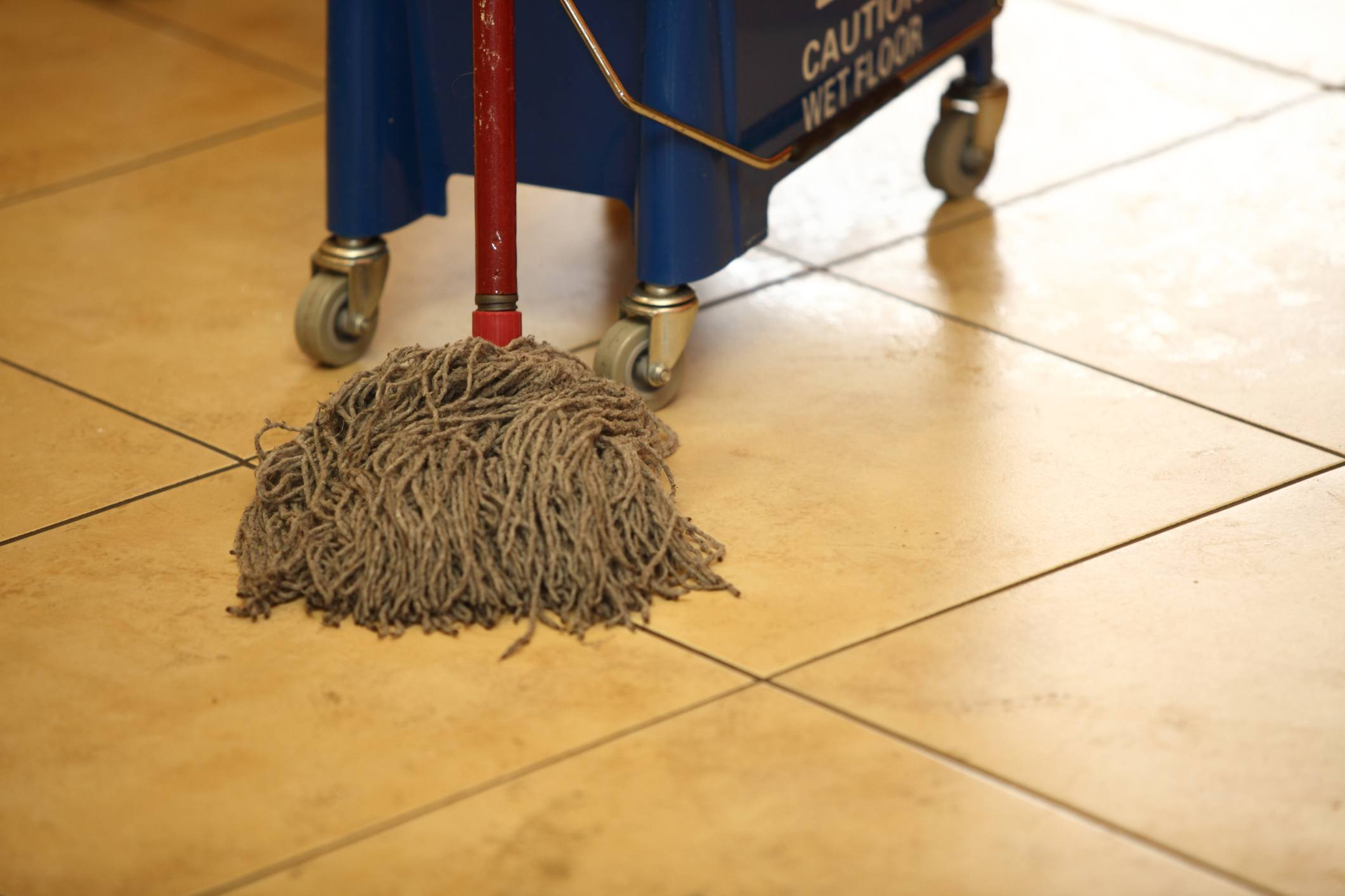 cleaning the floor with a old mop, mopping