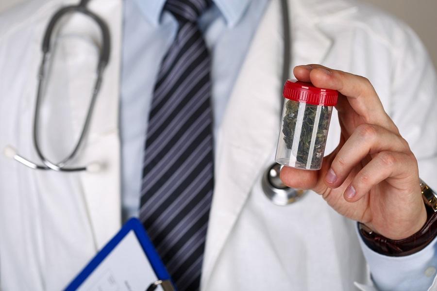 Doctor's hand holding medical marijuana