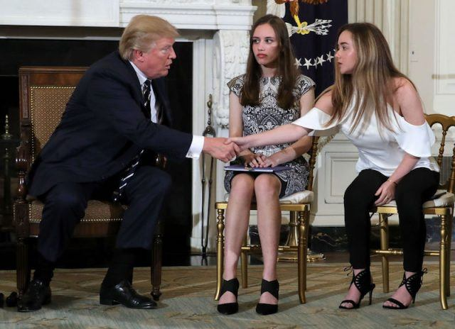 Donald Trump shaking hands with a student from Marjory Stoneman Douglas High School.
