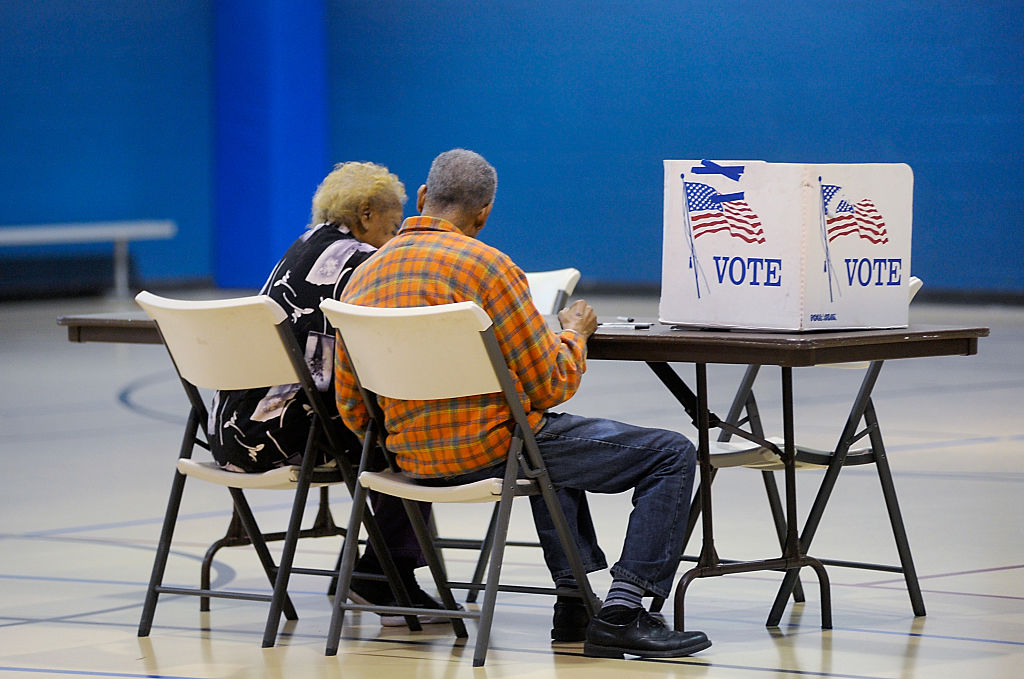 elderly couple reads a ballot prior to voting on November 8, 2016 in Durham, North Carolina.