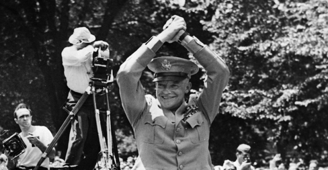 Eisenhower celebrating while standing outdoors.