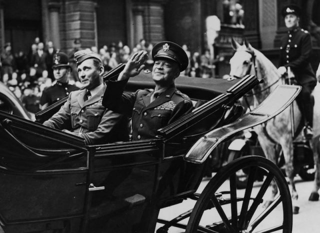 Dwight Eisenhower sitting in a carriage.