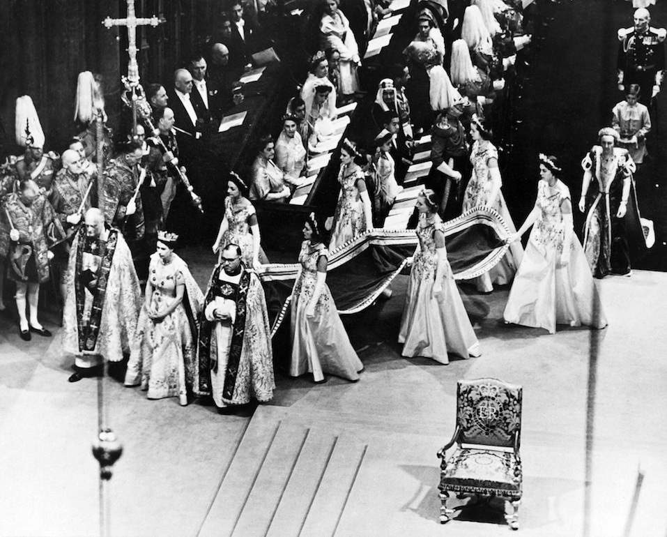 Queen Elizabeth II, surrounded by the bishop of Durham Lord Michael Ramsay nd the bishop of Bath and Wells Lord Harold Bradfield, walks to the altar