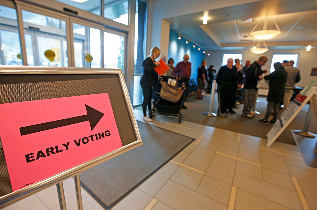 People stand in line to vote on the first day of early voting at the Provo Recreation Center, on October 25, 2016 in Provo, Utah