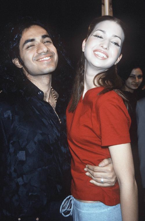 Ivanka Trump posing backstage at a fashion show with fashion designer Anand Jon.