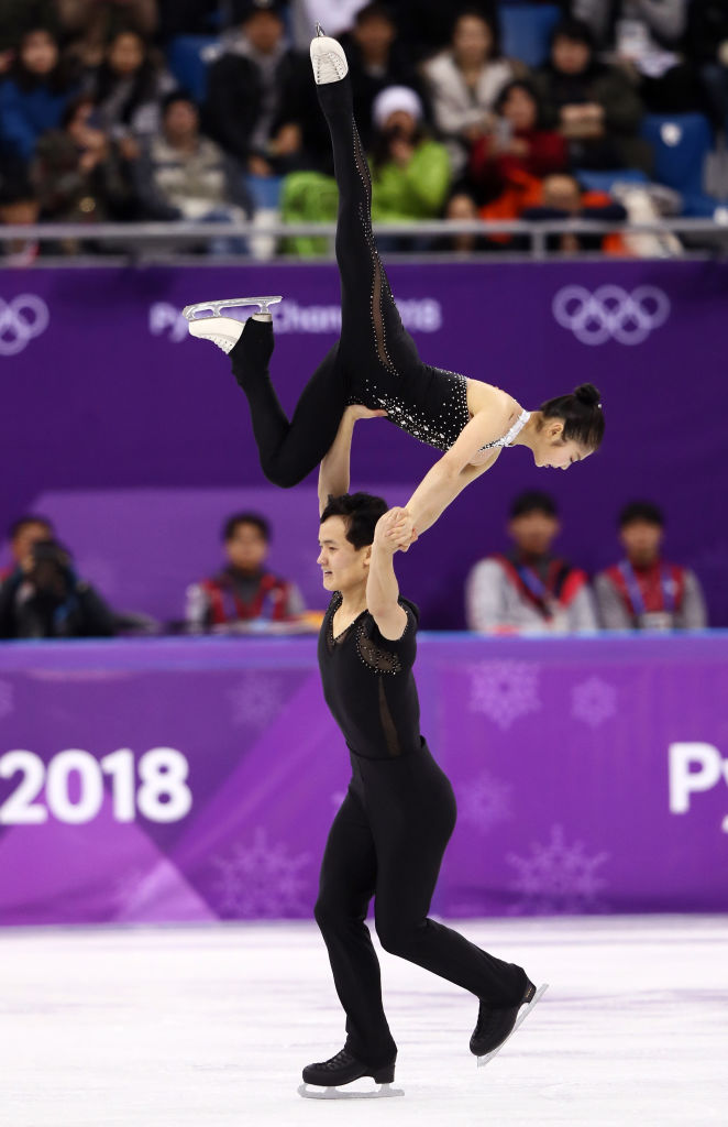 Tae Ok Ryom and Ju Sik Kim of North Korea compete during the Pair Skating Free Skating