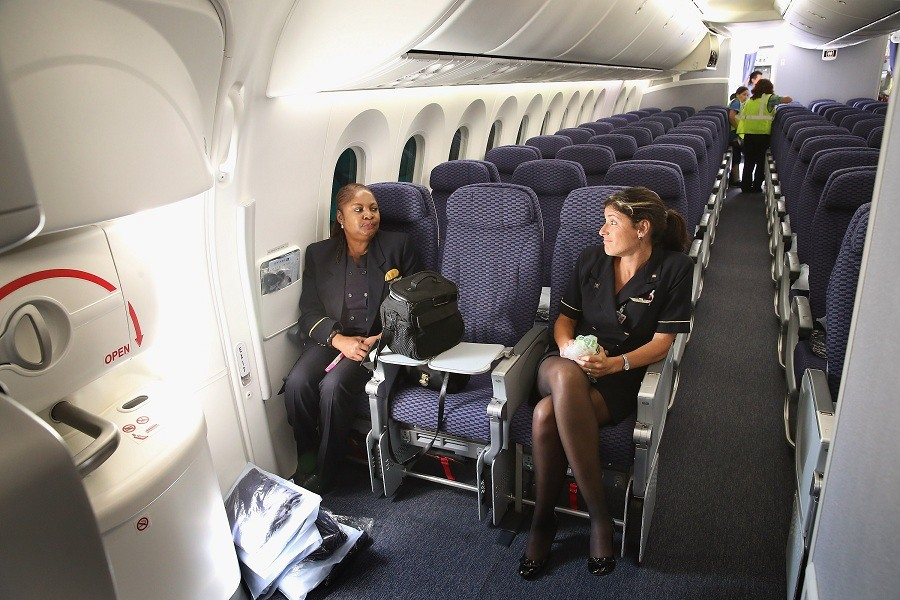 Flight attendants relax after arriving at O'Hare International Airport