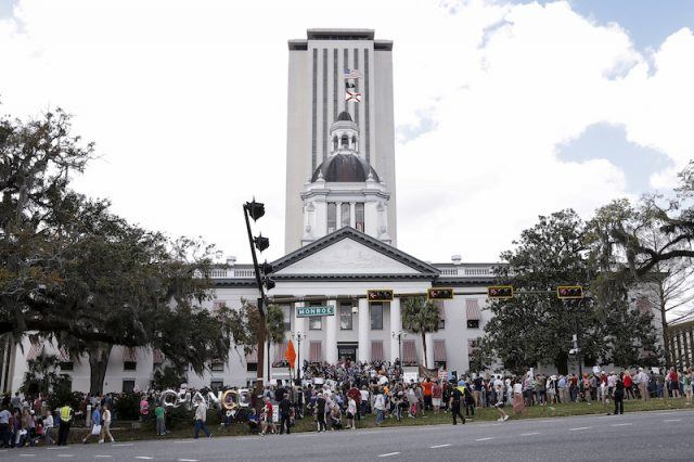 Students protesting in front of the Florida State Capitol.