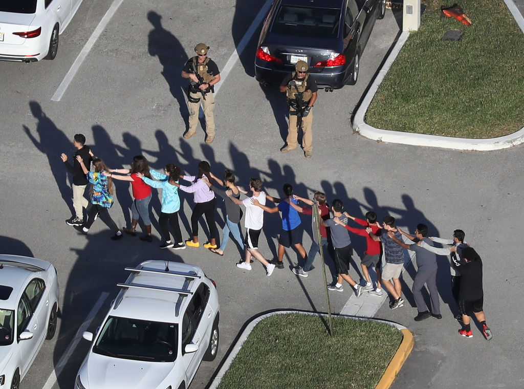 students walk to safety in Parkland, Florida