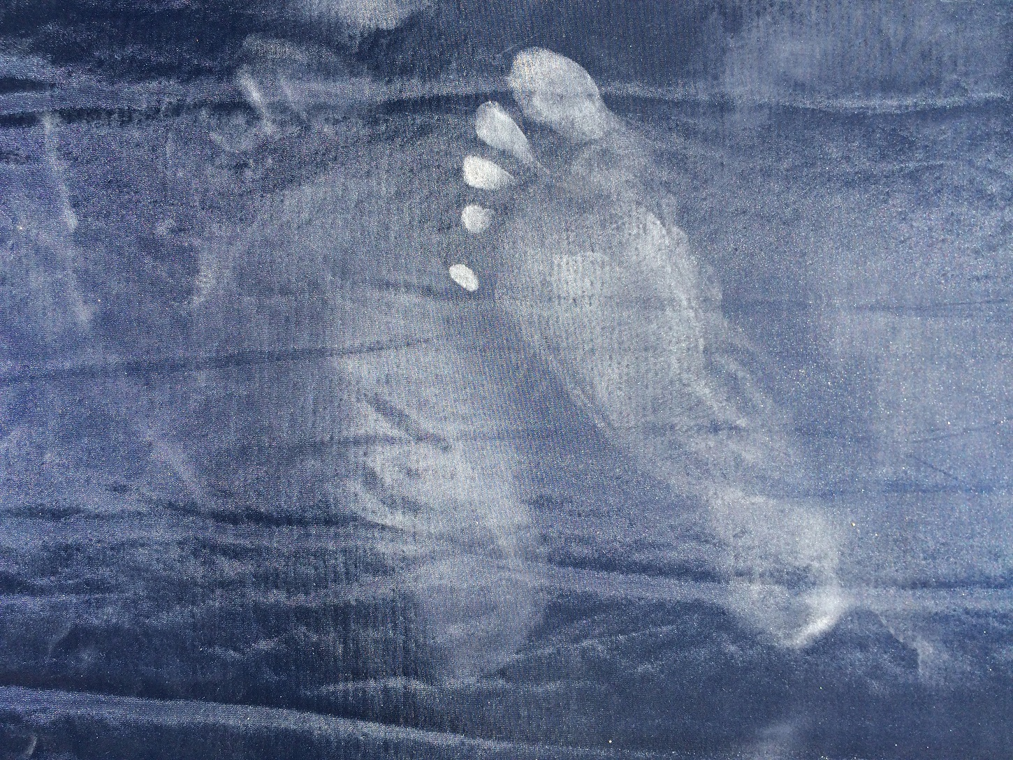 Dusty footprint on textile background