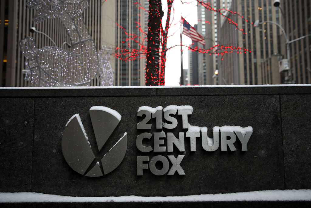Signage for 21st Century Fox stands outside