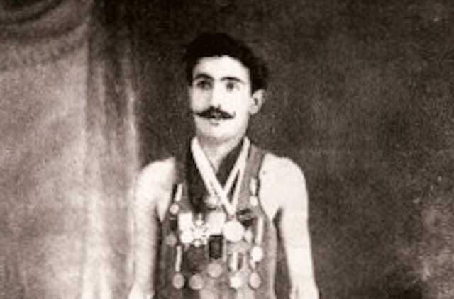 Francisco Lazaro wearing several medals.