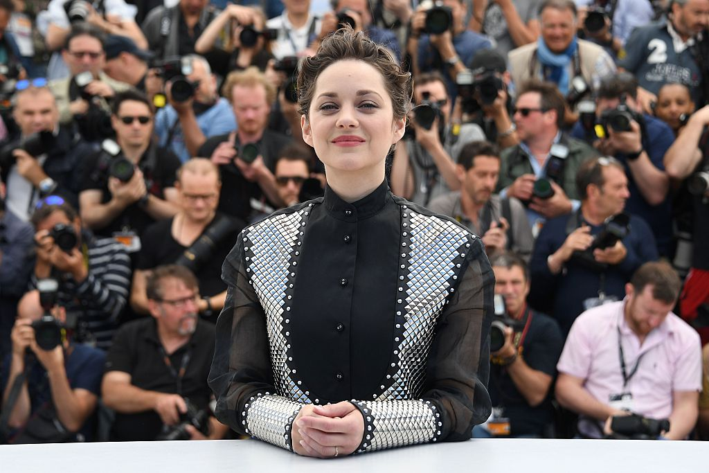 French actress Marion Cotillard wearing metallic embellished clothing