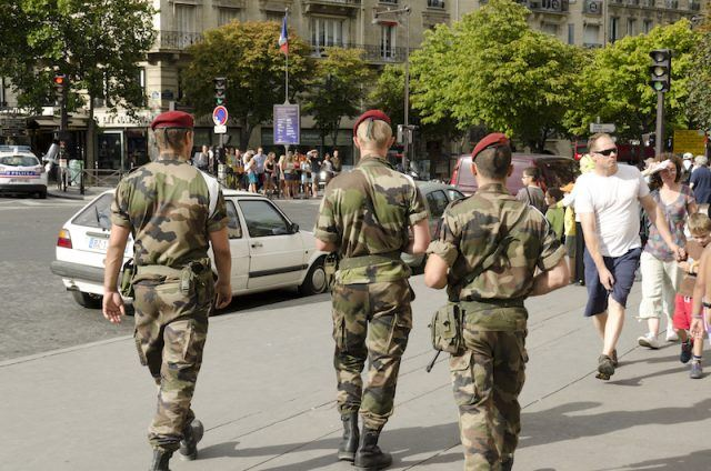 A group of French soldiers patrolling the streets.