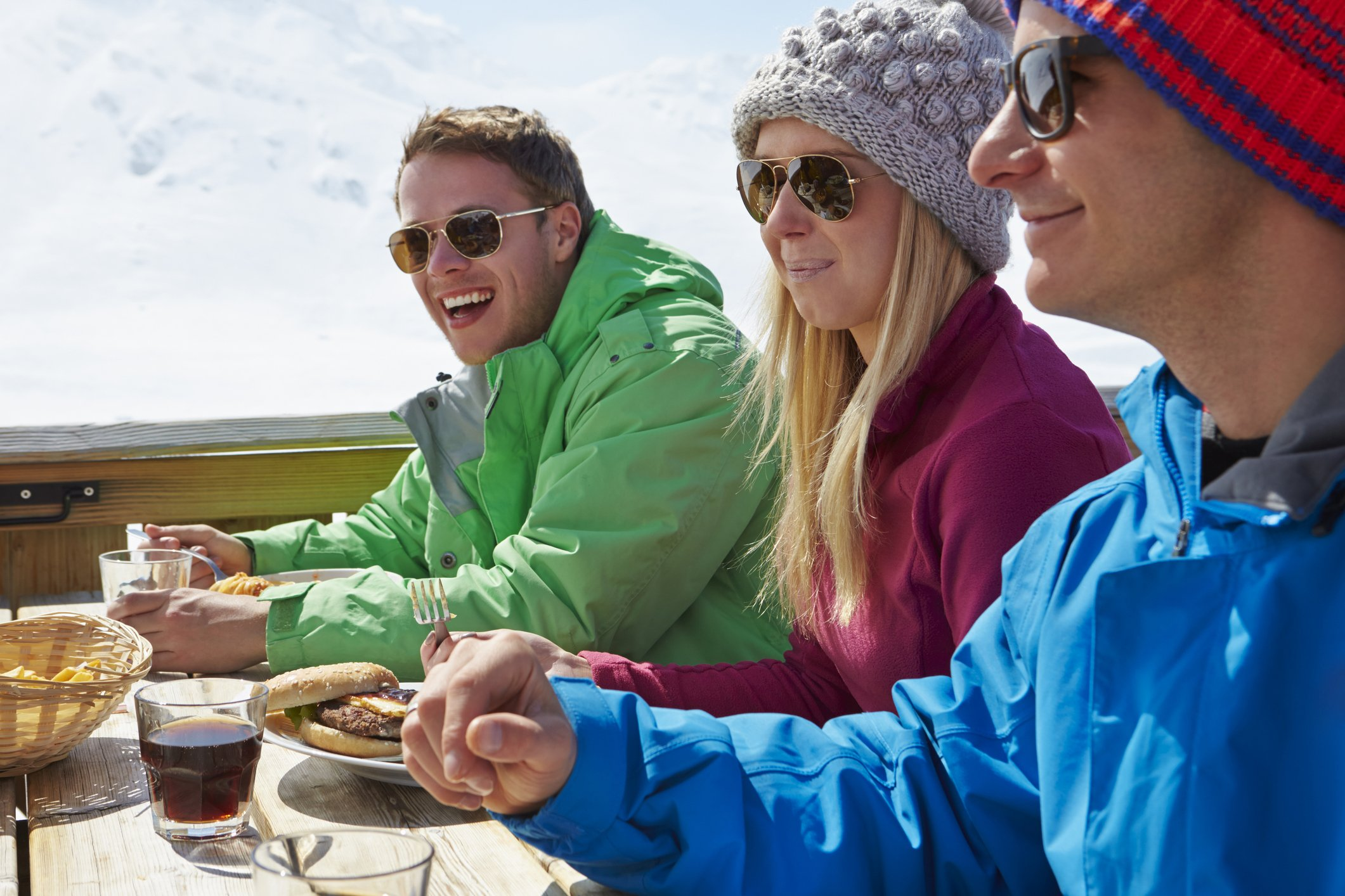 Friends eating at mountain ski restaurant