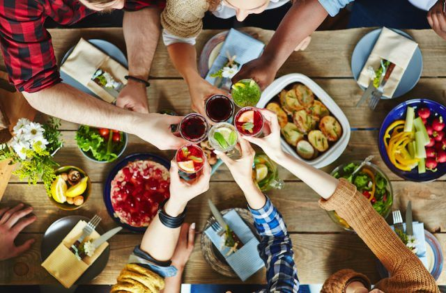 A group of friends enjoying drinks and food.
