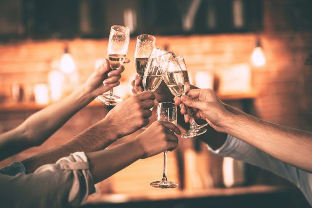 A group of friends toasting with champagne.