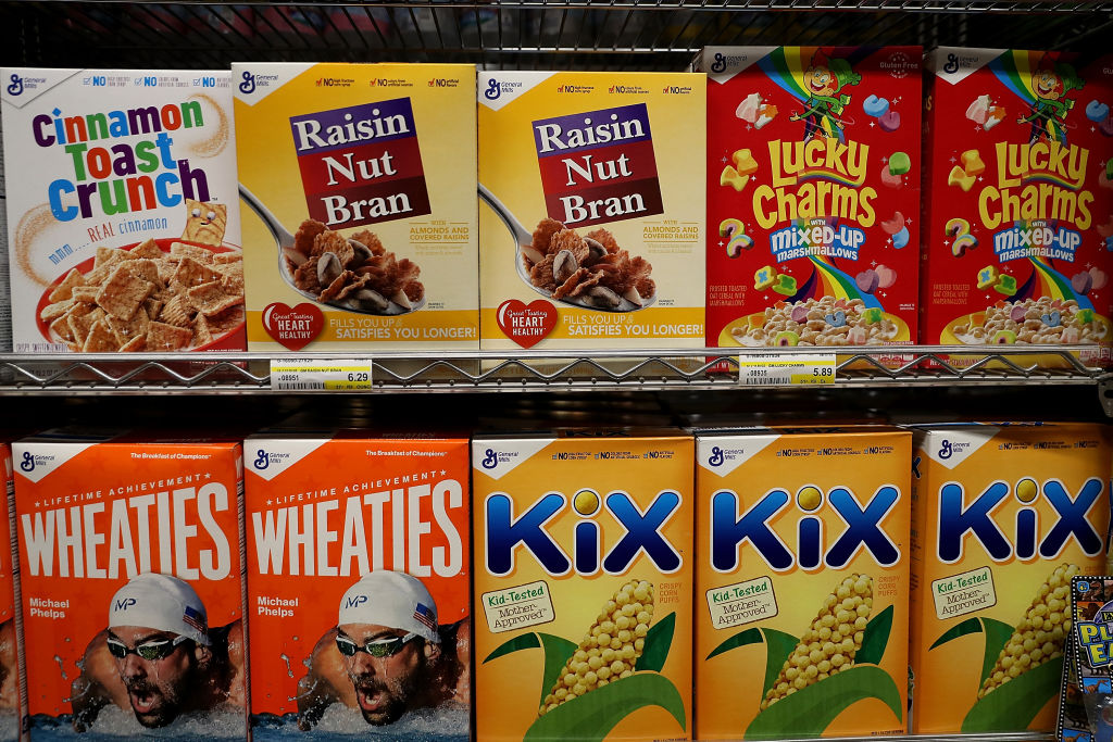 Boxes of General Mills brand cereals are displayed at Scotty's Market
