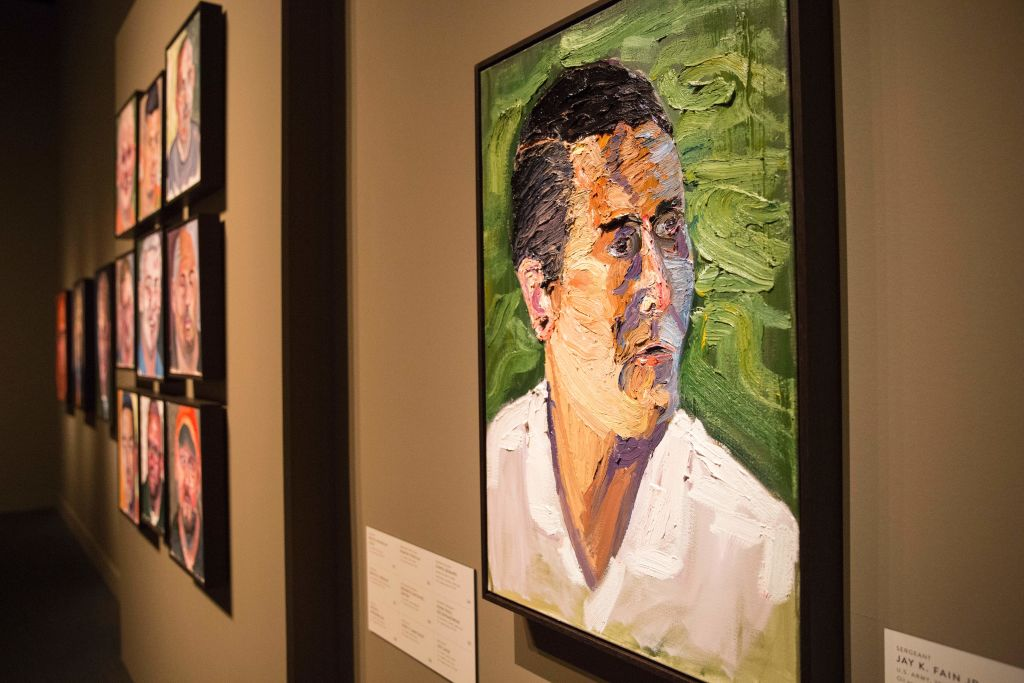 "Paintings of wounded US military veterans painted by former US President George W. Bush hang in ""Portraits of Courage"""