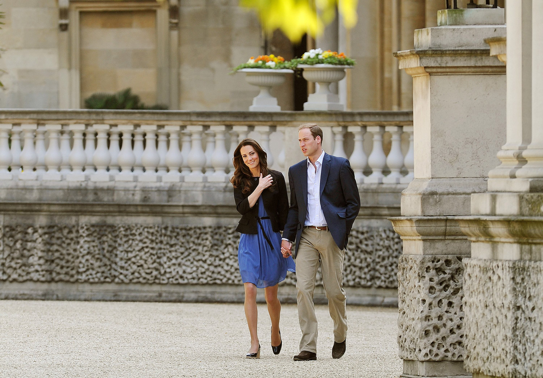 Prince William, Duke of Cambridge and Catherine, Duchess of Cambridge walk hand in hand from Buckingham Palace