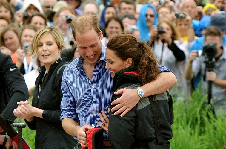 Prince William, Duke of Cambridge hugs his wife Catherine, Duchess of Cambridge .