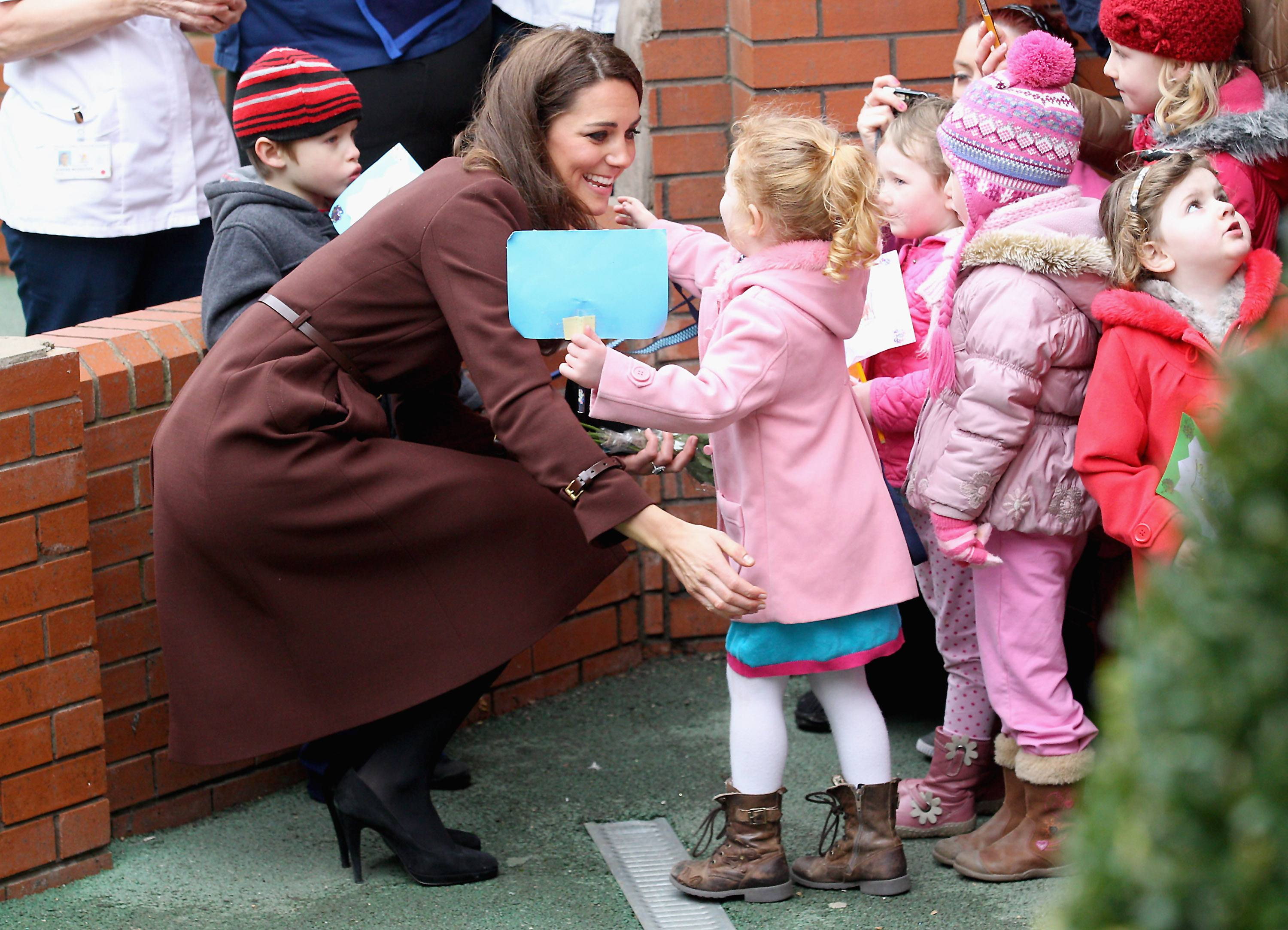 Catherine, Duchess of Cambridge hugs a young girl as she visits Alder Hey Children's NHS Foundation Trust on February 14, 2012 in Liverpool, England. The Duchess has spent the day in Liverpool and arrived at Alder Hey Hospital after a visit to 'The Brink'.