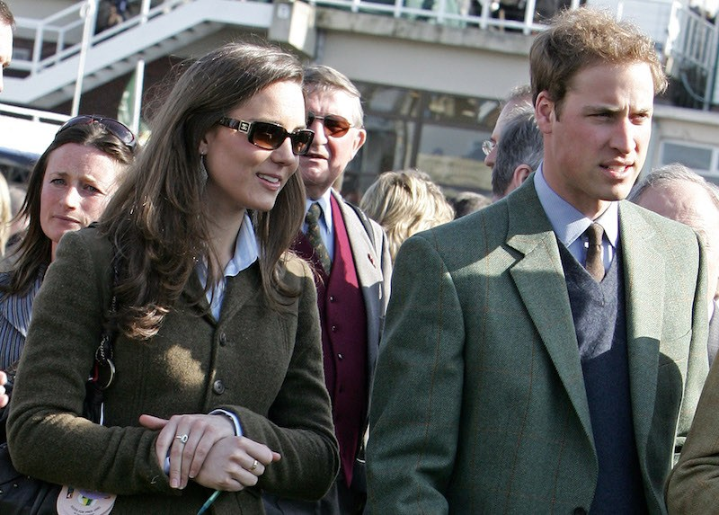 Britain's Prince William (R) stands beside girlfriend Kate Middleton (L) in the paddock enclosure on the first day of the Cheltenham Race Festival at Cheltenham Race course, in Gloucestershire 13 March 2007. (Photo credit should read CARL DE SOUZA/AFP/Getty Images)