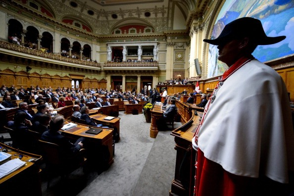 A Swiss usher stands in the Parliament room of the Swiss Federal Assembly.