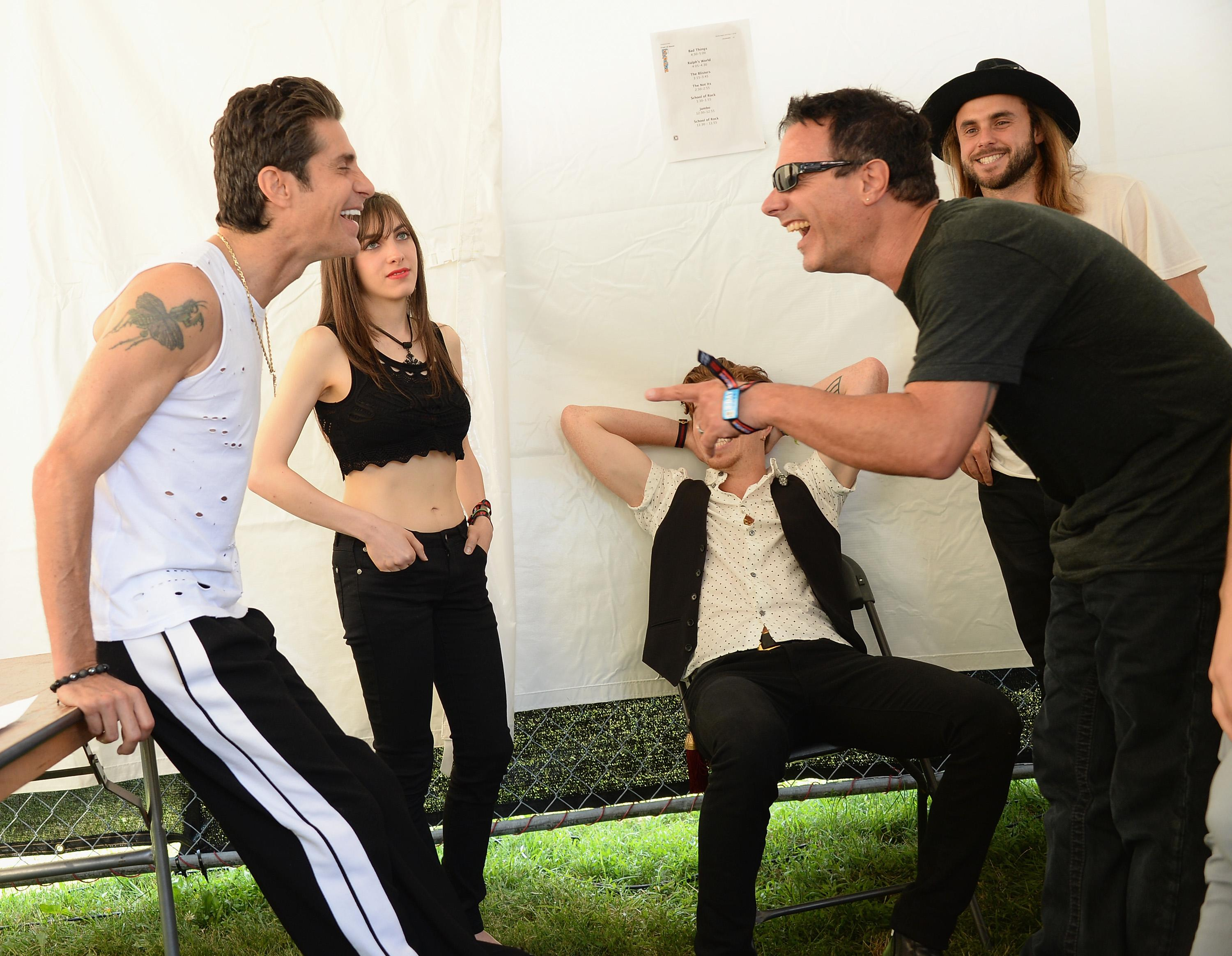 Lollapalooza founder Perry Farrell speaks with Lena Zawaideh, Shawn White and Anthony Sanudo of Bad Things during Lollapalooza 2013 at Grant Park on August 3, 2013 in Chicago, Illinois.