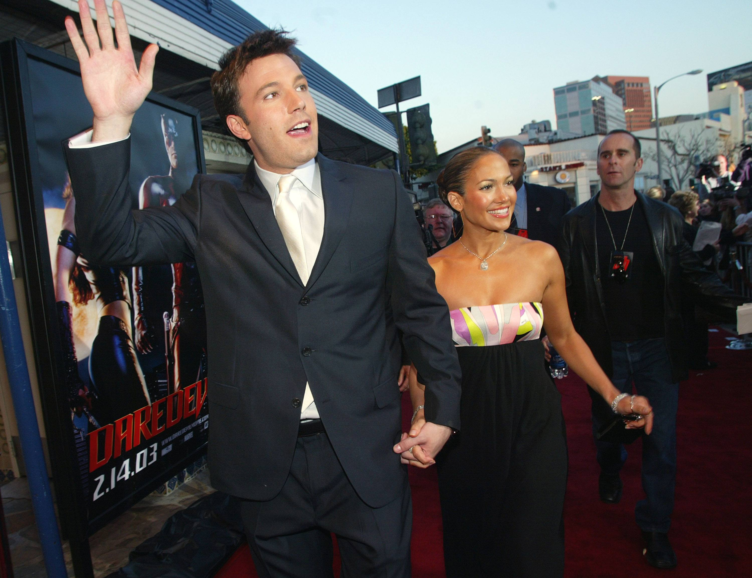 Actor Ben Affleck (L) and his fiance actress/singer Jennifer Lopez arrive at the premiere of 'Daredevil' at the Village Theatre on February 9, 2003 in Los Angeles, California.