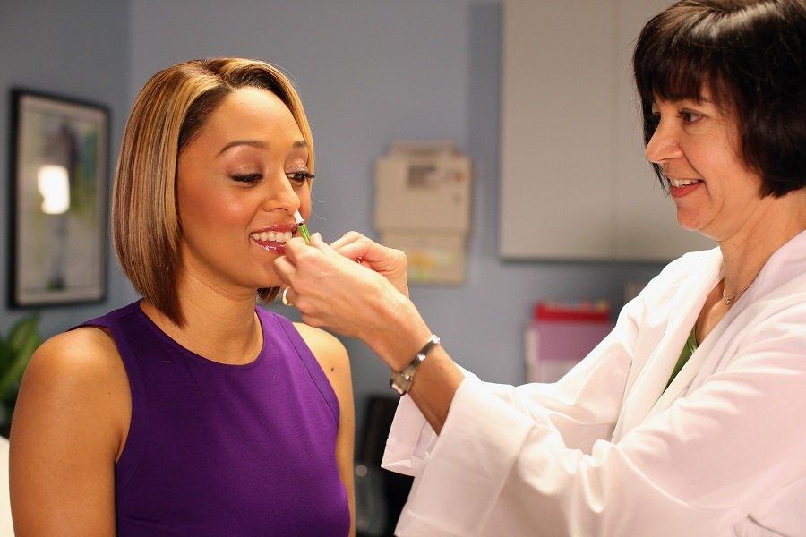 Actress Tia Mowry receives FluMist