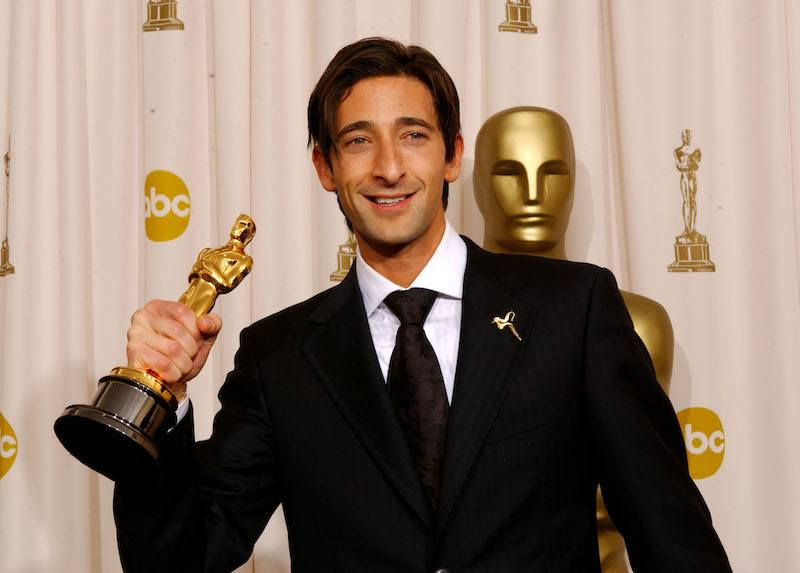 """HOLLYWOOD - MARCH 23: Actor Adrien Brody poses with his Best Performance By An Actor In A Leading Role award for """"The Pianist"""" during the 75th Annual Academy Awards at the Kodak Theater on March 23, 2003 in Hollywood, California. (Photo by Frank Micelotta/Getty Images)"""