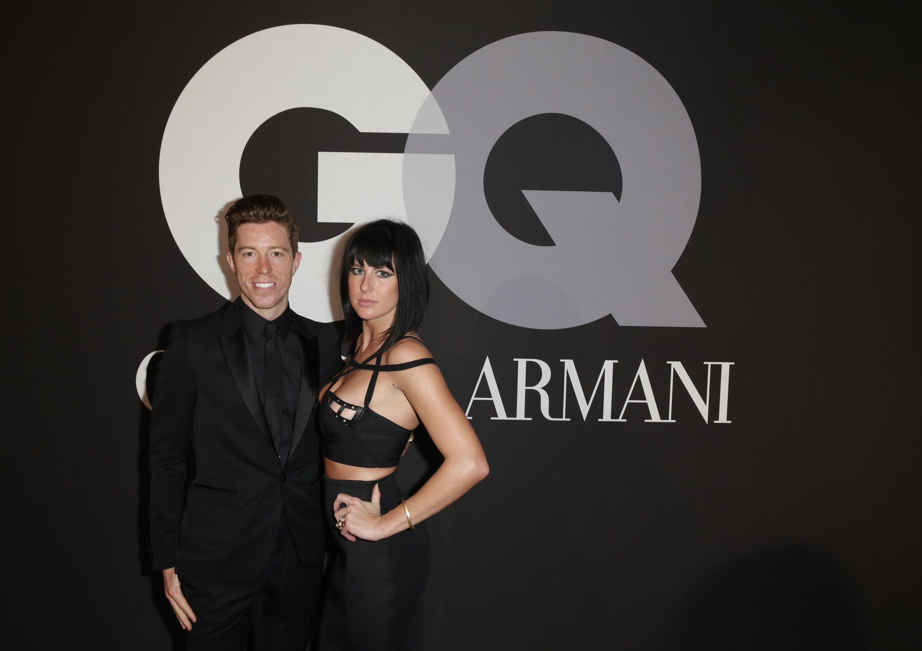 Professional snowboarder Shaun White (L) and recording artist Sarah Barthel of music group Phantogram attend GQ and Giorgio Armani Grammys After Party at Hollywood Athletic Club