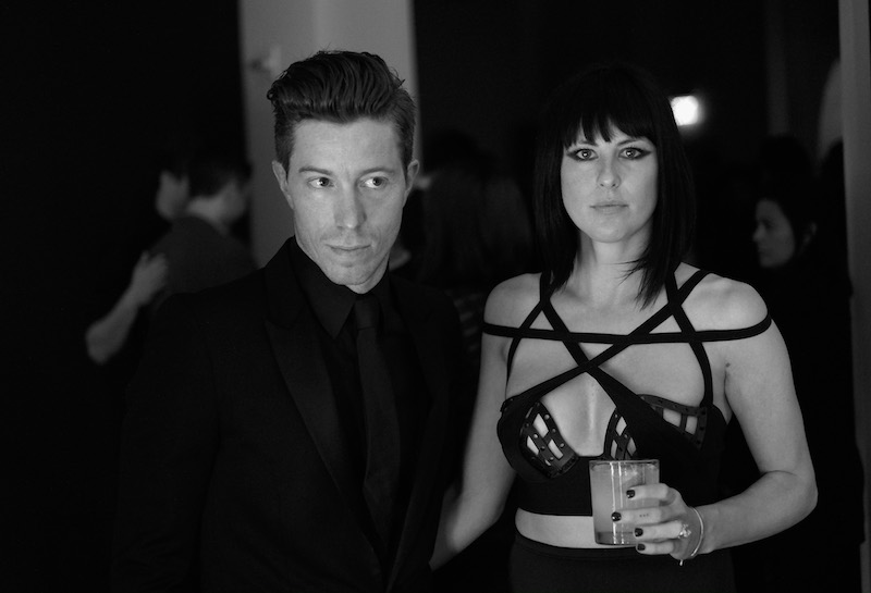 HOLLYWOOD, CA - FEBRUARY 08: (EDITORS NOTE: Image has been converted to black and white.) Professional snowboarder Shaun White (L) and recording artist Sarah Barthel of music group Phantogram attend GQ and Giorgio Armani Grammys After Party at Hollywood Athletic Club on February 8, 2015 in Hollywood, California. (Photo by Michael Buckner/Getty Images for GQ)